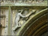 Censing angel in the spandrel of the west doorway (Salle)